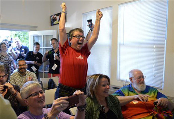 Tina Reynolds celebrates the Supreme Court decision at the LGBT Sacramento Community Center on Wednesday in Sacramento, Calif. The court's ruling cleared the way for the resumption of same-sex marriage in the state of California.