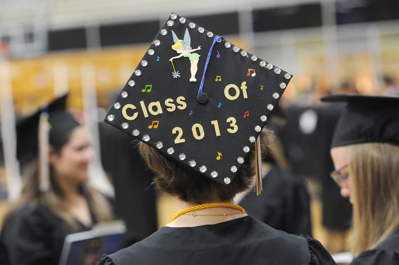 A graduate of the University of Southern Maine shows her status at commencement in May. A new report by Sallie Mae finds that the largest single source of college financing is grants and scholarships, supplanting parents' contributions. USM