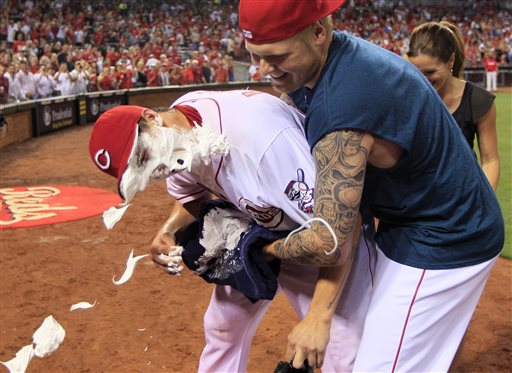 Cincinnati Reds starting pitcher Homer Bailey, left, gets a face full of shaving cream from Mat Latos after Bailey threw a no-hitter against the San Francisco Giants in a baseball game, Tuesday, July 2, 2013, in Cincinnati. Cincinnati won 3-0. (AP Photo/Al Behrman)