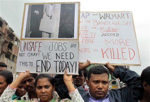 Bangladeshi garment workers, relatives and activists participate in a protest demanding that companies sign the Accord on Fire and Building Safety in Savar, Bangladesh, on June 29, 2013.