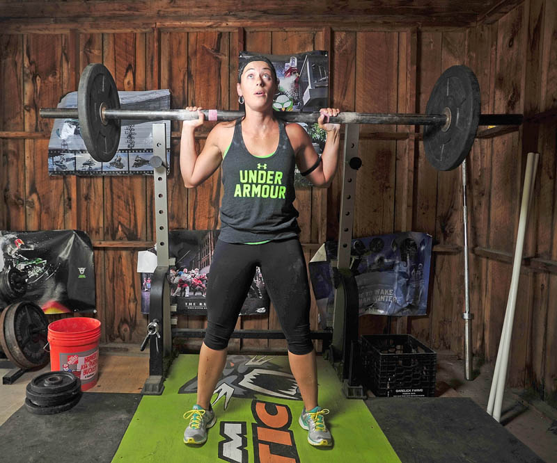 """WORKING HARD: Holly MacKenzie, winner of the Under Armor """"What's Beautiful"""" contest, works out in her gym in the garage at her Oakland residence on Tuesday."""