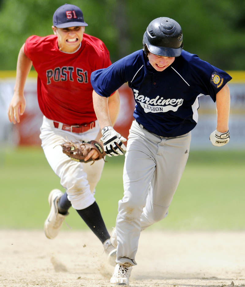 RUN DOWN: Post 51's Jacob Dexter, left, runs down Gardiner's Zach Farrin during an American Legion Baseball Zone 2 tournament game Sunday in Augusta.