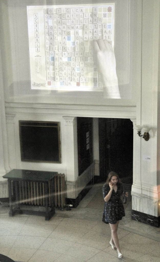 A Maine International Film Festival-goer enters the lobby of the old post office in downtown Waterville on Saturday, as Alejandro Cesarco's