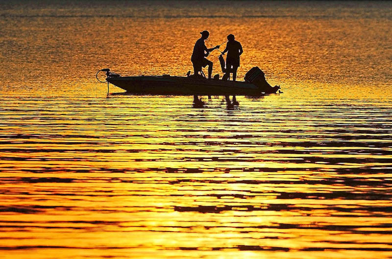 Fisherman cast their lines on to a sun drenched Great Pond in Belgrade on Sunday. The pond was made famous by Ernest Thompson's screenplay,