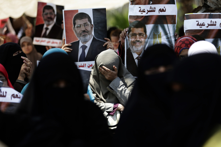 A supporter of ousted Egyptian President Mohammed Morsi cries during a protest near the University of Cairo in Giza, Egypt, on Friday.