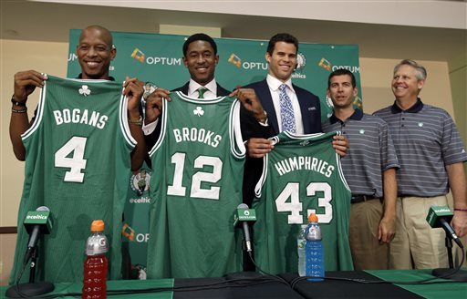 Newly acquired Boston Celtics players Keith Bogans, from left, MarShon Brooks and Kris Humphries hold up their jerseys as they pose with Celtics head coach Brad Stevens and president of basketball operations Danny Ainge, far right, in Waltham, Mass., Monday, July 15, 2013, after a news conference to introduce players they acquired from the Brooklyn Nets in exchange for Kevin Garnett and Paul Pierce. (AP Photo/Elise Amendola)