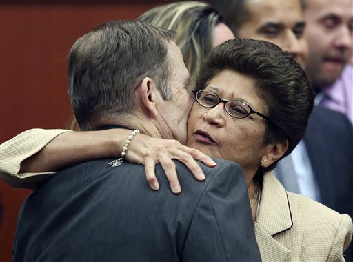 George Zimmerman's parents, Robert Zimmerman Sr. and Gladys Zimmerman, embrace following George Zimmerman's not guilty verdict in Seminole Circuit Court in Sanford, Fla., tonight.