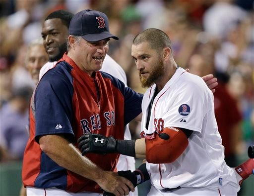 Boston Red Sox outfielder Jonny Gomes, right, is congratulated by manager John Farrell after his pinch-hit walk-off solo home run in the ninth inning of an interleague game against the San Diego Padres on Wednesday at Fenway Park in Boston. Boston won 2-1.