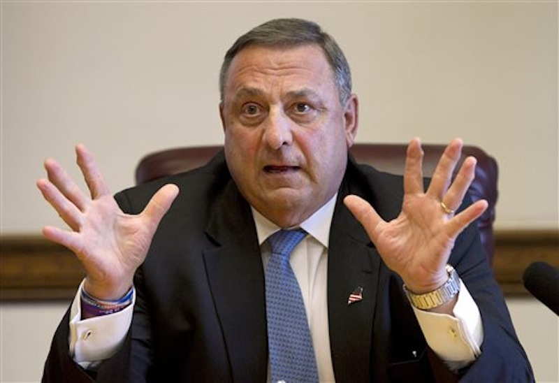 In this June 26, 2013 file photo, Gov. Paul LePage speaks to reporters shortly after the Maine House and Senate both voted to override his veto of the state budget at the State House in Augusta, Maine. LePage vetoed an increase in the state's minimum wage Monday, July 8, 2013. (AP Photo/Robert F. Bukaty, File)