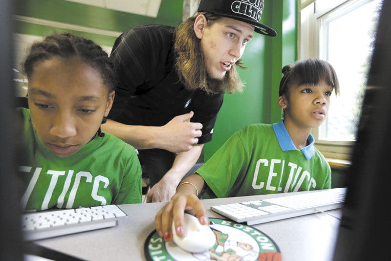 LET ME TAKE A LOOK: First-round draft pick Kelly Olynyk, center, assists Jillian Ayler, 11, left, and Kanashia Howard, 12, both of Boston, in a technology lab at the Mildred Ave Teen Center on Monday in Boston. The Celtics introducted Olynyk and second-round pick Colton Iverson on Monday.