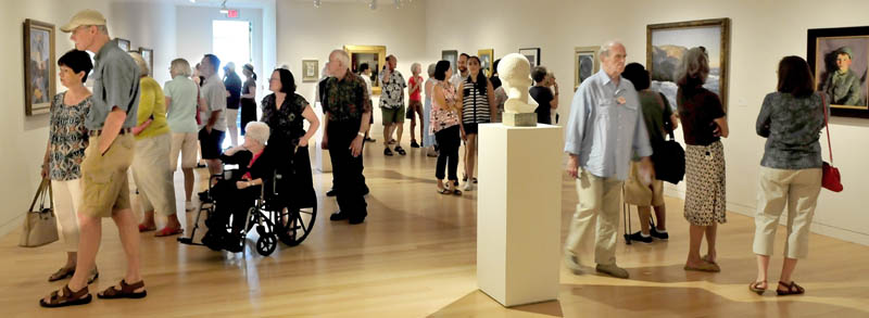 There were more patrons than art pieces in one of the sections of the expanded Colby College Museum of Art in Waterville during Community Day on Sunday.