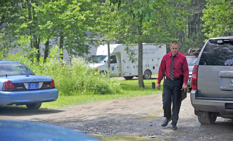 Maine State Police search the residence at 24 Main St in Detroit on Friday where a man was found dead Thursday morning.