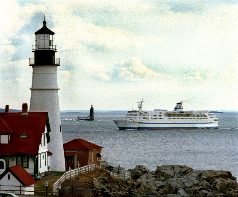 In this April 8, 1997 file photo, the Scotia Prince returns to Portland, Maine for the summer season as it passes the Portland Head light with Ram Island lighthouse in the background. Nova Scotia officials are optimistic that an experienced ferry operator will take their $21 million offer and relaunch a service next summer between Nova Scotia and New England. Portland has been identified as the leading contender to be the U.S. port.