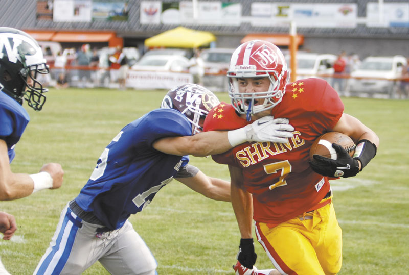 BREAKING FREE: Cony High School graduate Chandler Shostak, right, breaks away from Noble's Ethan Beaulier to score a touchdown for the East in the first half of the Maine Shrine Lobster Classic on Saturday at Waterhouse Field in Biddeford. Shostak had five receptions for 155 yards in the East's 25-13 victory.