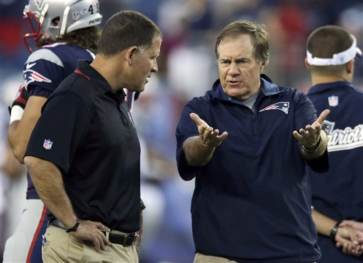 Tampa Bay Buccaneers head coach Greg Schiano, left, listens to New England Patriots head coach Bill Belichick as their teams warm up before an NFL preseason football game Friday, Aug. 16, 2013, in Foxborough, Mass. (AP Photo/Charles Krupa)