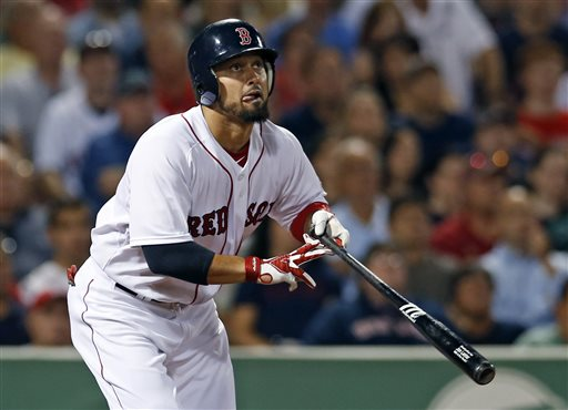 Boston Red Sox's Shane Victorino hits a two-run double against the Baltimore Orioles during the seventh inning of a baseball game at Fenway Park in Boston, Tuesday, Aug. 27, 2013. Victorino homered twice and drove in a career-high seven runs to lead the Red Sox to a 13-2 victory over the Orioles. (AP Photo/Elise Amendola)