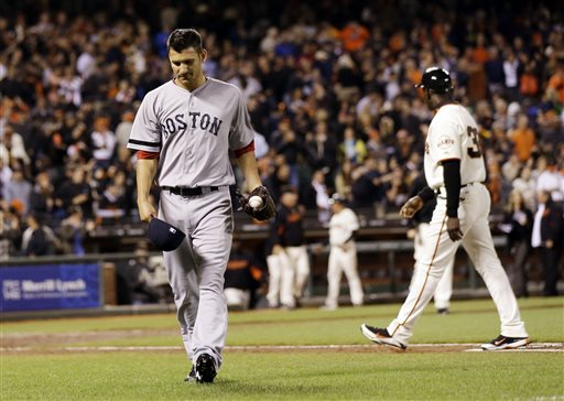 Boston Red Sox reliever Brayan Villarreal, left, walks off the field after giving up the game-winning run on a bases-loaded walk to San Francisco Giants' Marco Scutaro during the ninth inning of an MLB Inter-league baseball game on Tuesday, Aug. 20, 2013, in San Francisco. San Francisco won 3-2. (AP Photo/Marcio Jose Sanchez)