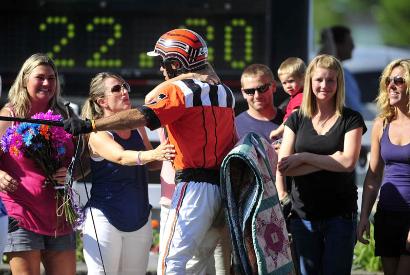 GOOD JOB: W. Drue Campbell, driver of the winning horse Real Special is congratulates in the winner's circle after the Walter H. Hight Memorial Pace on Saturday at the Skowhegan Fairgrounds.