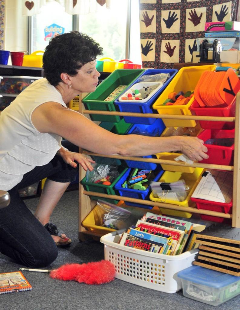 Kindergarten teacher Nancy Stover organizes her classroom on Aug. 20 at Dresden Elementary School.