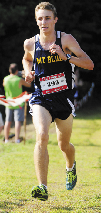 ON THE WAY TO VICTORY: Mt. Blue High School senior Josh Horne runs to victory at the Scot Laliberte Invitational cross country race Friday in Augusta. Horne finished the 2.4 mile course in 13 minutes, 21.95 seconds to beat teammate Aaron Willingham by eight seconds.