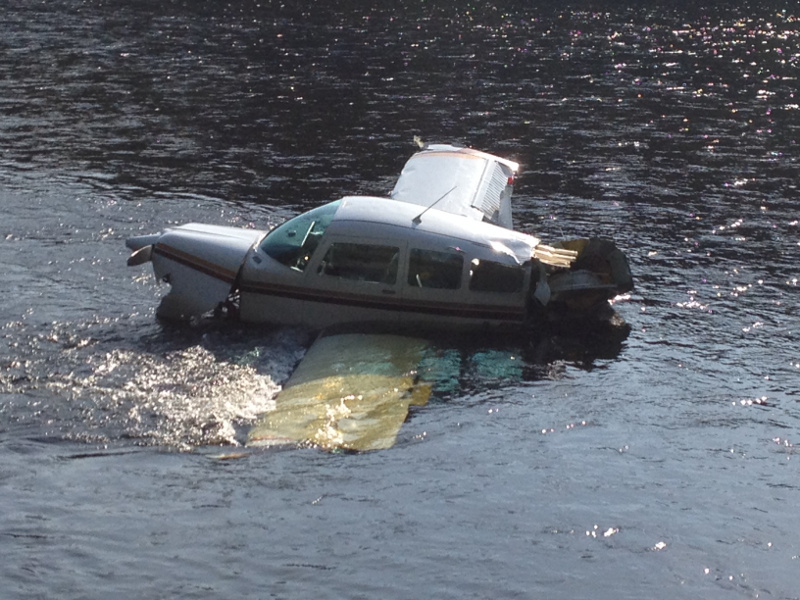 The fuselage of a single-engine Beechcraft airplane is seen in the Kennebec River in Bingham this afternoon. The airplane crashed into the river shortly after taking off from Gadabout Gaddis Airport.