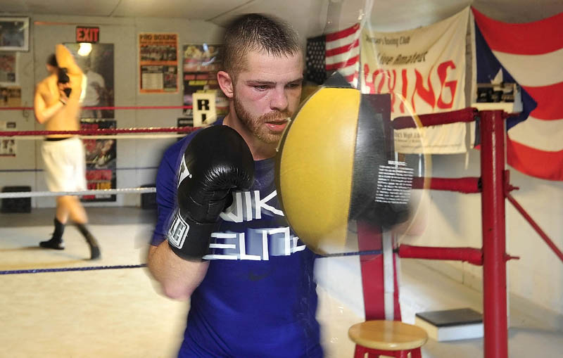 GETTING READY: Brandon Berry works the strike bag during a training session recently at Wyman's Boxing Club in Stockton Springs. Berry takes on Jesus Cintron in his third professional bout Thursday night in Manchester, N.H.