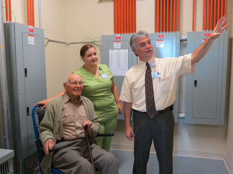 """Harold """"Bill"""" Armstrong, registered nurse Kirsten Mack and Rick Albert, MaineGeneral Health's director of engineering and plant operations, check out some electrical panels in the new hospital in north Augusta that is set to open in November."""