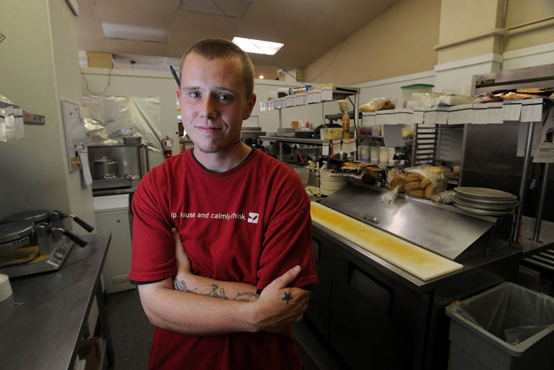 Evan McSwain, a cook at Selah Tea in downtown Waterville, has been uninsured for the last five years.