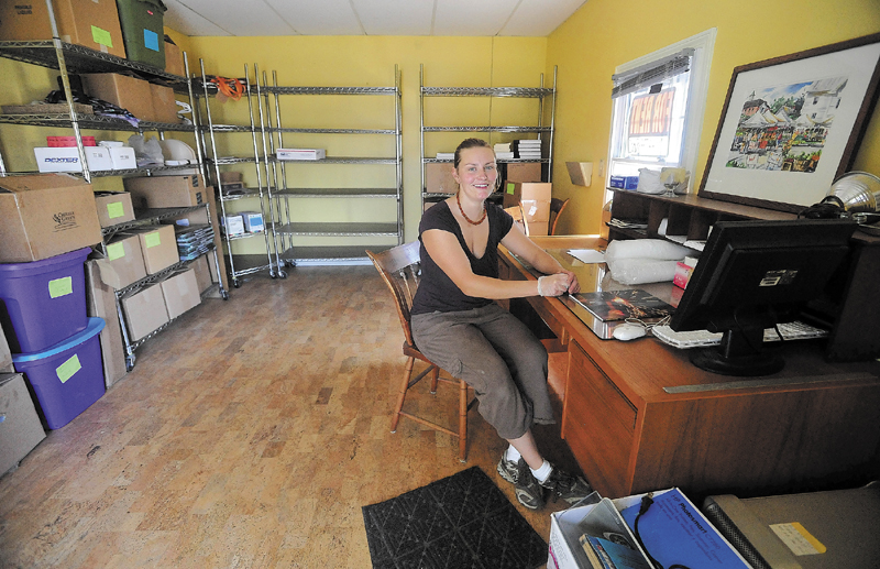 Sarah Smith sits at a desk at the Pickup Cafe in Skowhegan. The concept of the pop-up store is for a prospective retailer to try out the spot for a day, week or month.