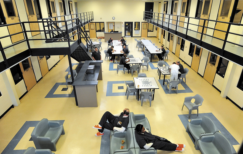 Inmates read and play board games in the day room in the medium security wing at the Somerset County Jail in East Madison in Feburary. Somerset County officials say they were omitted from the jails panel as punishment.
