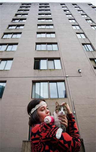 Stephanie Gustafson holds Wasabi in front of the Mendenhall Apartment building in Juneau, Alaska.