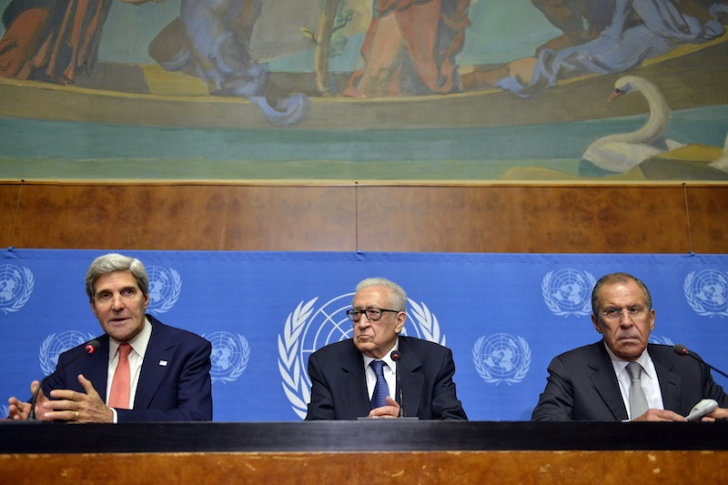 U.S. Secretary of State John Kerry, from left, UN Joint Special Representative for Syria Lakhdar Brahimi and Russian Foreign Minister Sergei Lavrov appear during a news conference following their meeting at the European headquarters of the United Nations in Geneva, Switzerland, Friday, Sept. 13, 2013. Kerry and Lavrov say the prospects for a resumption in the Syria peace process are riding on the outcome of their chemical weapons talks. (AP Photo/Keystone, Martial Trezzini)