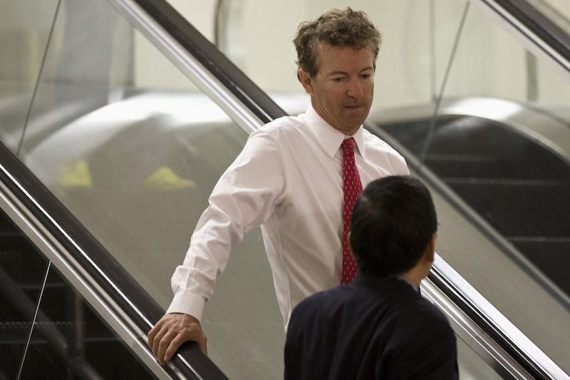 Sen. Rand Paul, D-Ky. rides an escalator on Capitol Hill in Washington, Tuesday, Sept. 3, 2013, on his way to attend a joint Senate and House intelligence closed-door briefing on Syria. A vote for war can make or break a White House hopeful. The politically fraught decision weighs on potential 2016 Republican candidates Sens. Rand Paul and Marco Rubio. (AP Photo/Jacquelyn Martin)