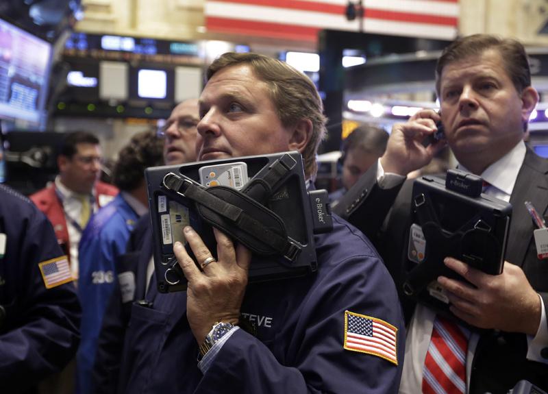 Traders Stephen Mara, left, and Edward Schreier work on the floor of the New York Stock Exchange on Wednesday.