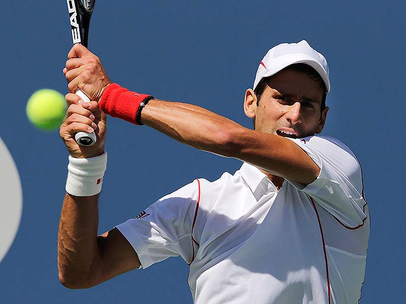 Novak Djokovic returns a shot to Stanislas Wawrinka in the semifinals at the 2013 U.S. Open tennis tournament on Saturday at New York. Djokovic won in five sets.