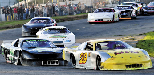 THEY'RE OFF: Ricky Morse (29) edges Josh St. Clair, left, at the start of the Last Chance Motorsports 150 race late Sunday at Unity Raceway.