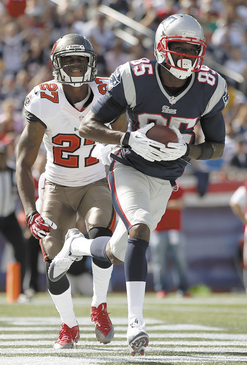 BIG DAY: New England Patriots wide receiver Kenbrell Thompkins (85) makes his second touchdown catch in front of Tampa Bay Buccaneers cornerback Johnathan Banks in the first half Sunday in Foxborough, Mass.