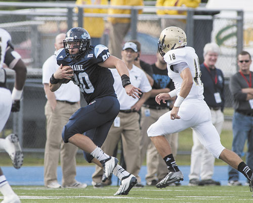 GET AWAY: Maine tight end Justin Perillo (80) is pursued by Bryant defensive back Bobby Rutland (18) in the second half Saturday in Orono.