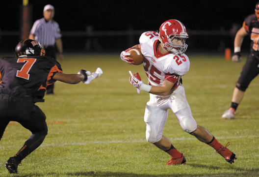 Cony's Tayler Carrier looks for running room after slipping past Brunswick's Taran Payne during the first half of the Rams' 54-38 loss Friday.