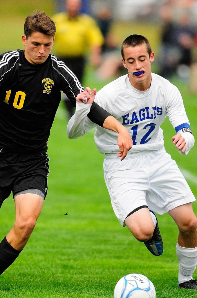 WHO'S GOT IT? Maranacook's Nick Lacasse, left, and Erskine's Ryan Rodrigue chase after a loose ball during Tuesday's game at Erskine Academy in South China.