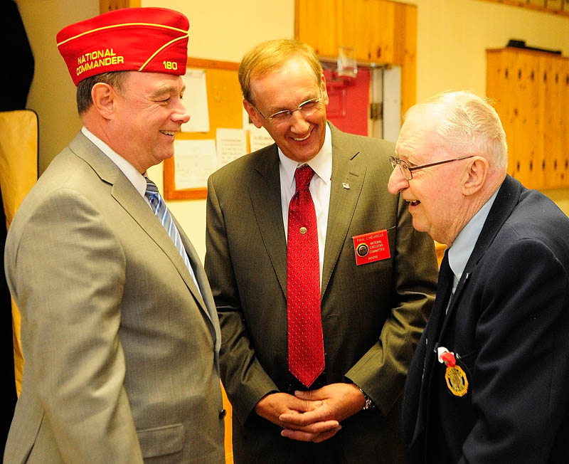 American Legion National Commander Daniel Dellinger, left, Paul L'Heureux, an American Legion National Executive Committee Member for Maine, and local American Legion member Donald Best, of Winthrop, chat on Saturday at the Alfred Maxwell Jr. Post 40 in Winthrop.