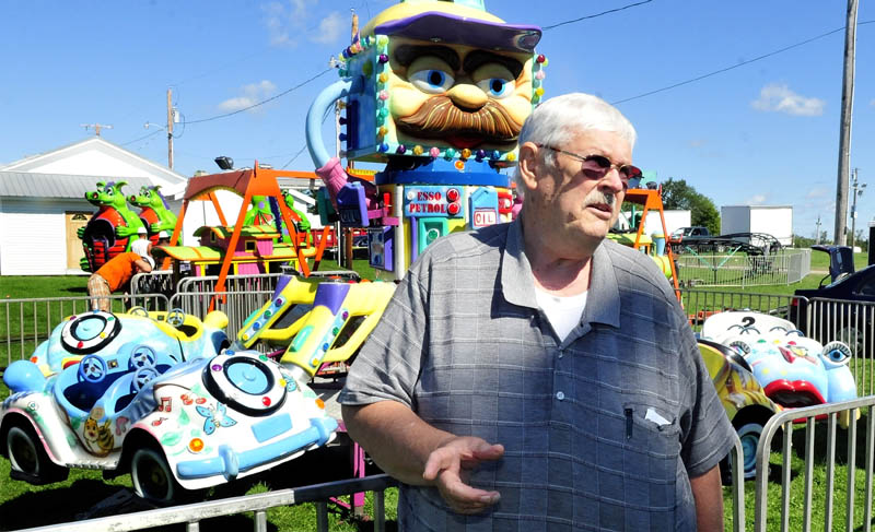 Jon Whitten speaks about his 60-year involvement with the Clinton Lions Club Fair as the midway is set up on Wednesday.