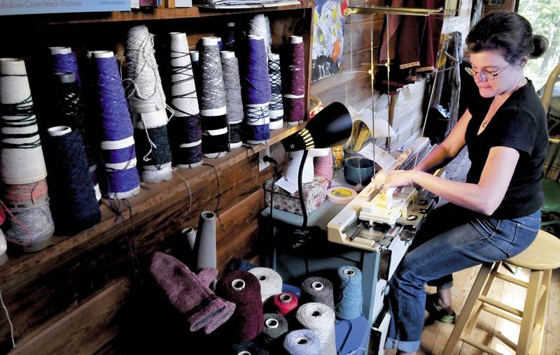 Karin Schott operates her hand-powered knitting machine at her home in New Sharon. Schott will display her knitting machine and skills at the Lewiston-Auburn Mini Maker Faire on Saturday.