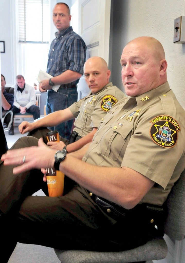 Franklin County Sheriff Scott Nichols, front, proposes withholding a county jail payment to the Board of Corrections during a Franklin County Commission meeting in Farmington today. Deputy Chief Steve Lowell is beside Nichols and Jail Administrator Doug Blauvelt is standing in the background.