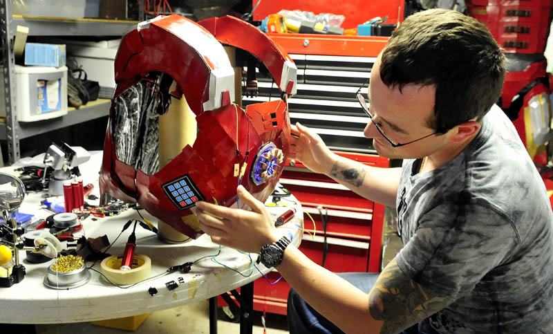 Tom Lemieux, of Oakland, works on the chest armor of his Iron Man suit.