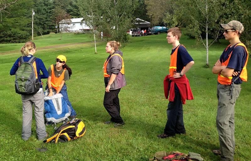 Members of Dirigo and Unity College search and rescue teams get ready to search behind the residence of Arthur Wakeman, 86, at his home at 344 East Benton Road in Benton on Thursday. Game wardens are searching for Wakeman who has been missing since Wednesday.