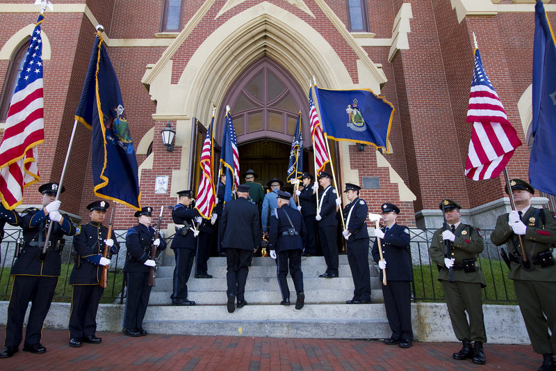 Public safety personnel enter the church for the Blue Mass, which takes place in Portland each year on the weekend closest to Sept. 11 to recognize the response to the 2001 terrorist attacks.