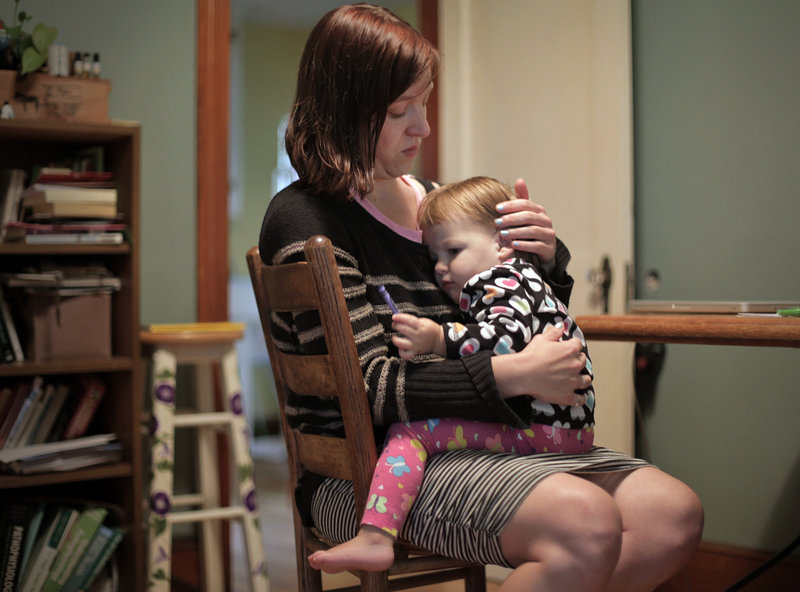 Erika Burkhart and her 18-month-old daughter, Lumi Stone, spend time together in their Portland home.