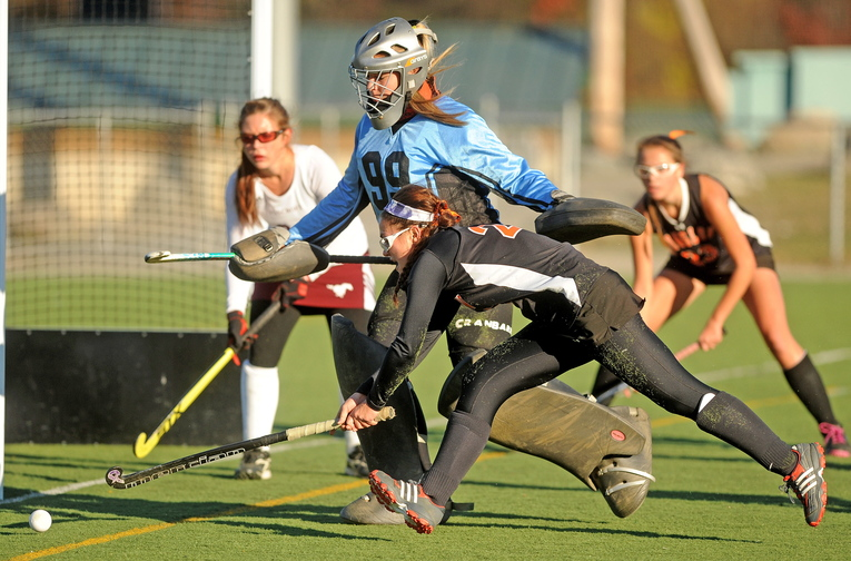 FIGHTING FOR IT: Winslow's Brooke Haskell, 24, tries to keep the ball in bounds as Foxcroft Academy goalie Brianna Skolfield, 99, defends in the first half of the Eastern Maine Class C championship game at Hamden Academy on Tuesday. Foxcroft Academy defeated Winslow 1-0.