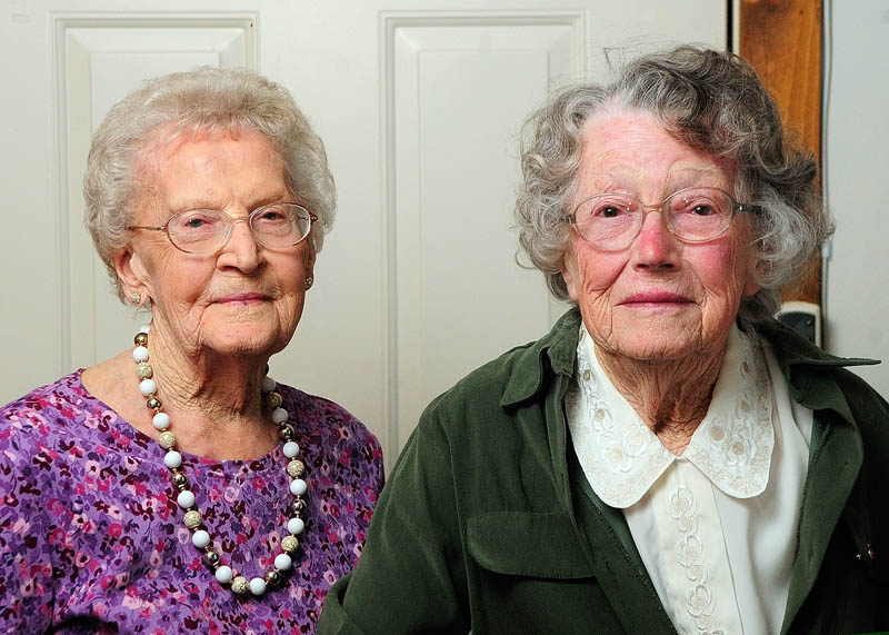 The oldest two members of the Belgrade High School class of 1933, Pearl Knowles Fisher and Ruth Endicott Freeman, pose for a photo on Thursday at Fisher's Augusta apartment.
